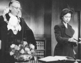 [H.R.H. Princess Elizabeth signs the visitors book in the Mayor's office]