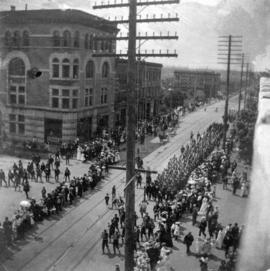 "[""Blue jackets"" marching north on Granville Street at Georgia Street for the arrival of..."