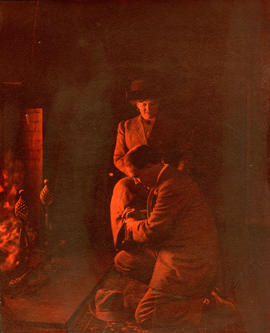 [A study of Alfred T. Layne and Daisy D'Avara at fireside]