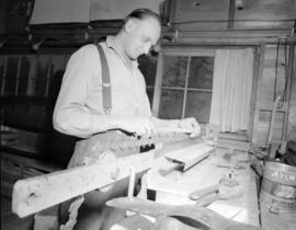 [Man adjusting saw blade at] Pacific Mills [on the] Queen Charlotte Islands