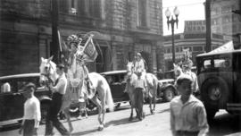 A Chinese parade with women on white horses