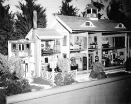 Display of open front scale model house