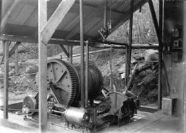 [Winch machinery under outdoor shelter for construction of Buntzen Lake Power Plant number one]