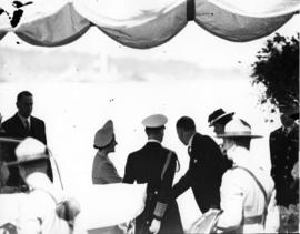 [King George VI and Queen Elizabeth being introduced to guests]