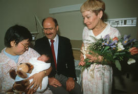 Mayor Harcourt and [Leora Apsouris] visiting with the Vancouver Centennial baby [Cheryl Lynn Alla...