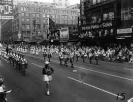 Pipe band and majorettes marching in 1955 P.N.E. Opening Day Parade