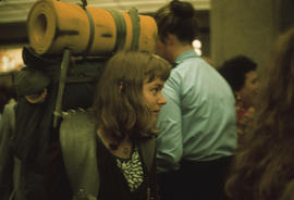 Debbie Wilson, one of the assistants (wearing backpack), at the airport