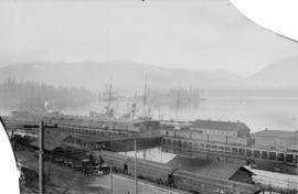 [C.P.R. railway station and wharf, showing trains and docked ships]