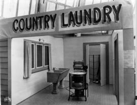 Display depicting a country laundry room