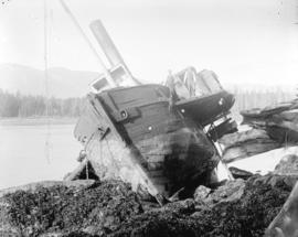 "[Two men standing on the wrecked ship S.S. ""Beaver"" at Prospect Point in Stanley Park]"