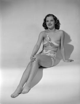 [Woman modeling a bathing suit]