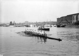 V.R.C. [Vancouver Rowing Club] eight-oared crew [rowing on Coal Harbour]
