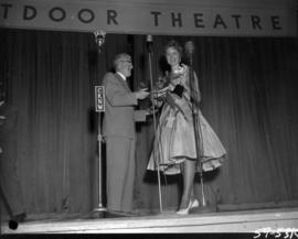 Anna Finlayson, winner of Miss P.N.E. 1959, on Outdoor Theatre stage with P.N.E. President J.F. B...