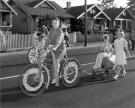 [The first and second prize winners on decorated bikes during a parade in Kerrisdale]