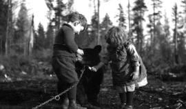 [Ken and Theresa Quiney with bear cub at 1820 Waterloo Street]