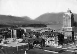 [Birdseye view of downtown buildings and houses on Hornby (500 and 600 block) and Dunsmuir Streets]