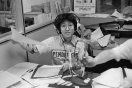 A Pender Guy volunteer at an on-air broadcast from Strathcona Community Centre