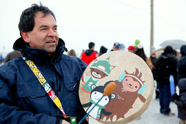 Day 93 Man drums his hand painted Olympic Mascot drum in Nak'azdli, British Columbia.