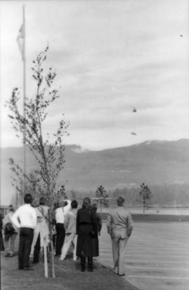 Group watching helicopter from parking lot