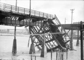 [Portion of fire damaged section of Connaught Bridge (Cambie Street Bridge), collapsed into False...