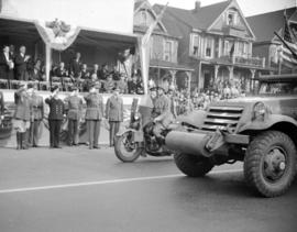 [Military parade passing by a stage along Burrard Street]