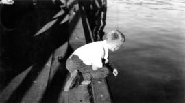 Young boy fishing off a dock