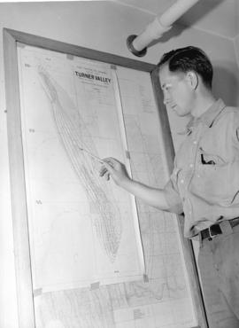 [Man with] map of Turner Valley