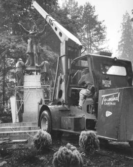 [Statue of Lord Stanley being lowered onto granite base in Stanley Park by Johnston Terminals Ltd.]