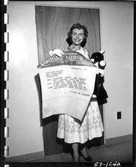 Colleen Black, contestant in Miss P.N.E. 1957, with telegram from citizens of Kamloops