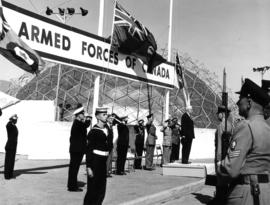 Lieutenant Governor G.R. Pearkes saluted at Armed Forces of Canada exhibit on P.N.E. grounds