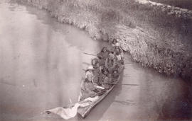 [Women and children in dugout canoe on Fraser River]