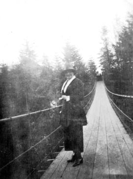 [Woman standing on Capilano Suspension Bridge]