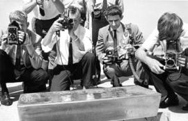 Photographers taking pictures of 1967 P.N.E. program grand prize $50,000 gold bar