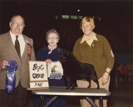 Best in Group [Non-Sporting Group: Schipperke] award being presented at 1976 P.N.E. All-Breed Dog...